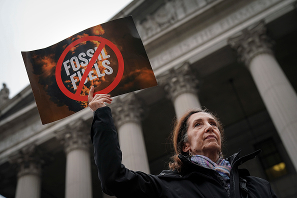 Environmental activists rally for accountability for fossil fuel companies outside of New York Supreme Court on Oct. 22, 2019 in New York City.