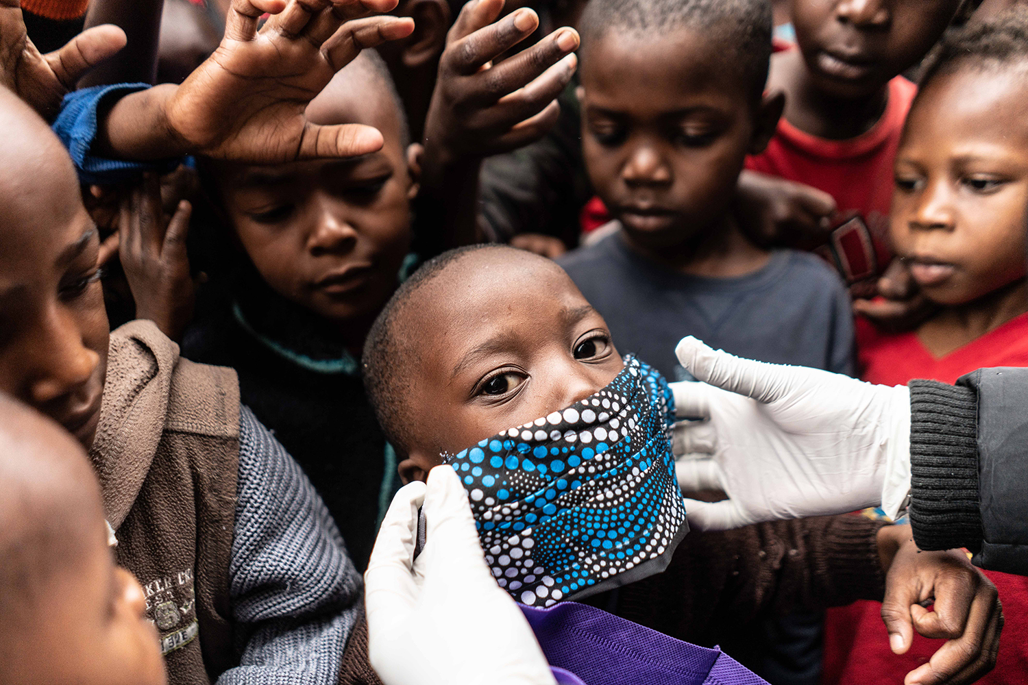 A boy tries on a face mask as food and masks are distributed by members of the Coalition for Grassroots Human Rights Defenders in Nairobi, Kenya, on April 25. FREDRIK LERNERYD/AFP via Getty Images