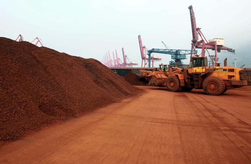 Soil containing rare earth minerals prepares to be loaded at a port in China.