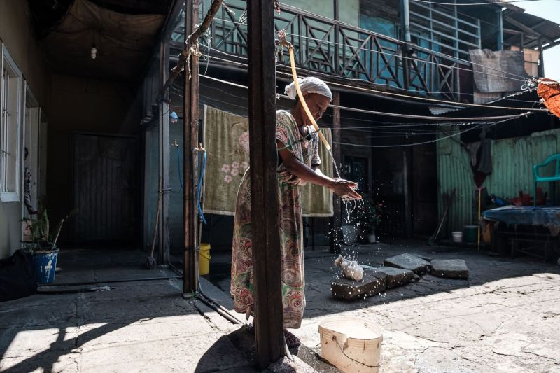 A woman washes her hands in the courtyard of her house in Addis Ababa, Ethiopia, on Nov. 1, 2018.