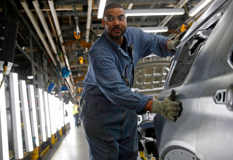 A worker assembles a car at the newly renovated Ford Assembly Plant in Chicago, on June 24, 2019.