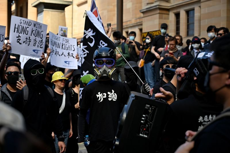 Supporters of Hong Kong pro-democracy protesters gather ahead of a march as part of the global anti-totalitarianism movement in Sydney on Sept. 29, 2019.