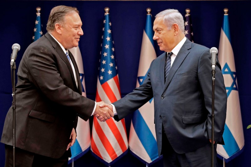Israeli Prime Minister Benjamin Netanyahu shakes the hand of U.S. Secretary of State Mike Pompeo following their meeting in Jerusalem on October 18, 2019.