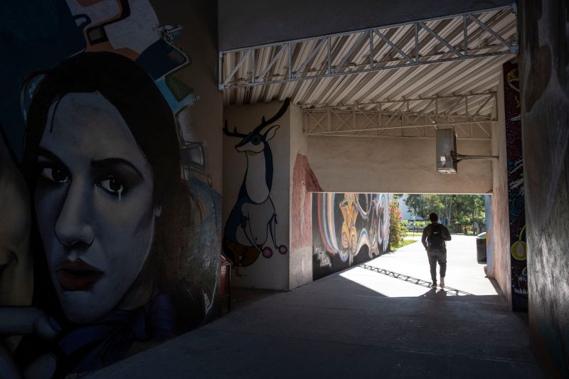 A student walks through the Universidad Autonoma de Baja California in Tijuana, Mexico, on March 9 during a day of national strike to denounce gender violence and the increasing toll of femicide.