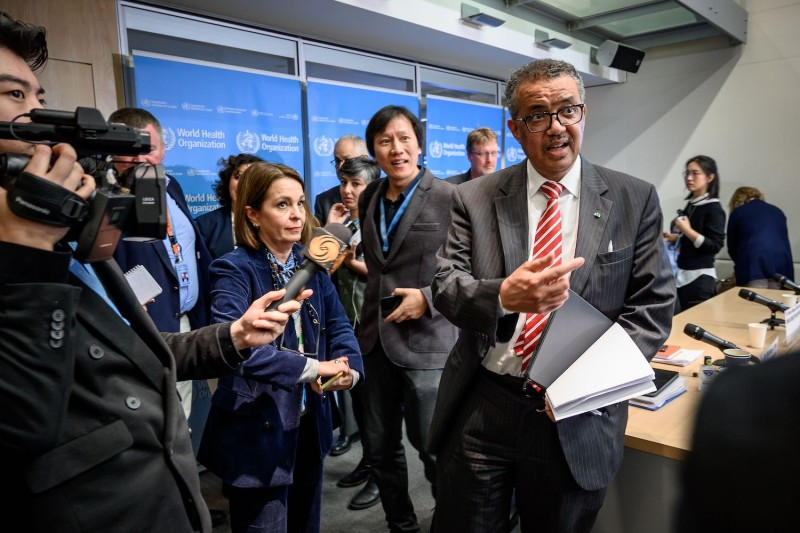 World Health Organization (WHO) Director-General Tedros Adhanom Ghebreyesus is surrounded by journalists at the end of a daily press briefing on COVID-19, at the WHO headquarters in Geneva on March 11, 2020.