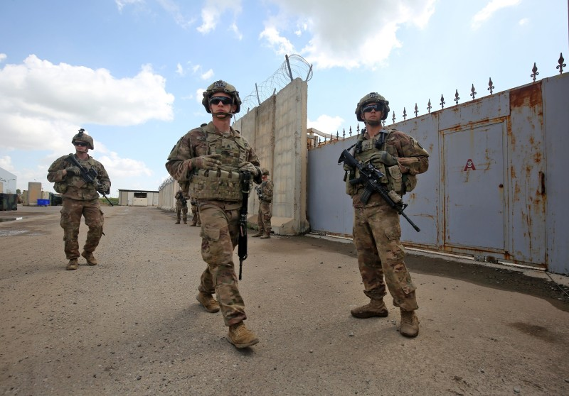 U.S. Army soldiers, part of the coalition against the Islamic State, at an air base northwest of Kirkuk, Iraq, before a planned pullout of U.S. forces, on March 29.