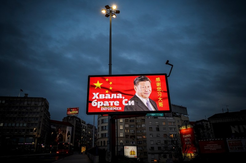 "A picture taken on March 30 shows a billboard bearing Chinese President Xi Jinping's face looking down over a boulevard in Belgrade next to the words ""Thank you brother Xi,"" a message paid for by a pro-government tabloid."