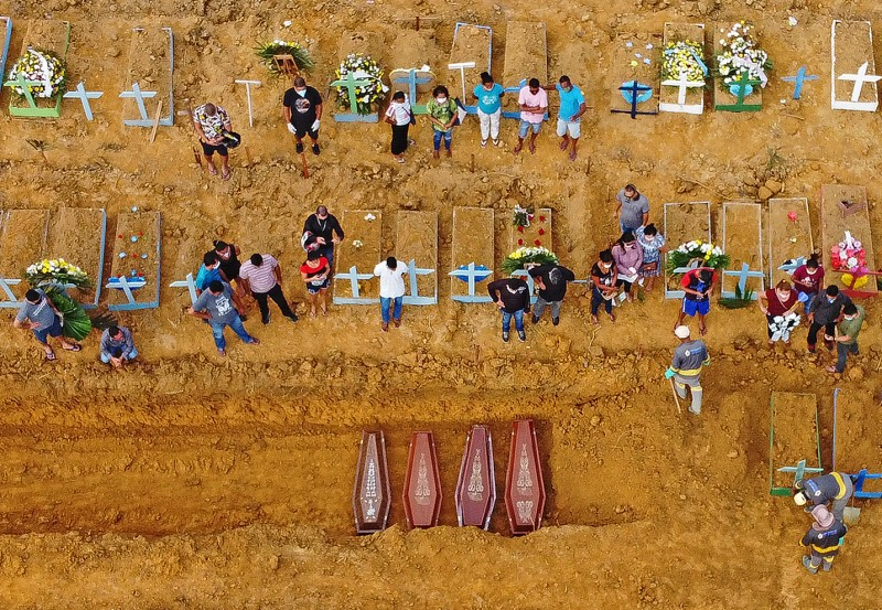 A burial takes place in a new cemetery area recently opened for suspected and confirmed coronavirus victims in Manaus, Brazil, on April 22.