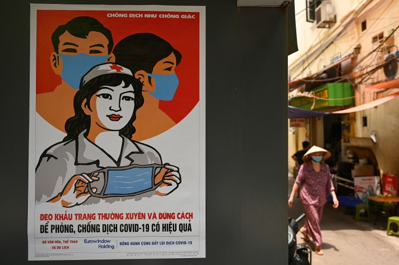 A propaganda poster on preventing the spread of the novel coronavirus is seen on a wall in Hanoi on April 29.