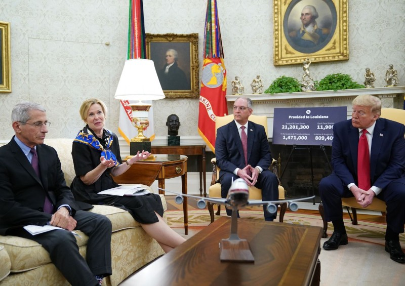 Anthony Fauci (left), the director of the National Institute of Allergy and Infectious Diseases, listens as Deborah Birx, the White House coronavirus response coordinator, speaks during a meeting with U.S. President Donald Trump and Louisiana Gov. John Bel Edwards in the Oval Office of the White House on April 29.