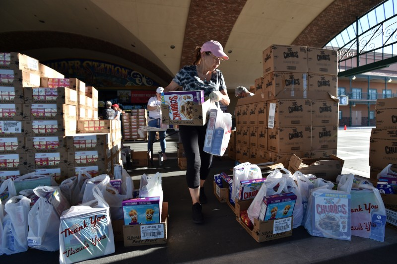 Volunteers prepare groceries to be given out at a drive-thru food bank in Las Vegas, Nevada in response to an increase in demand amid the coronavirus pandemic on April 29, 2020.