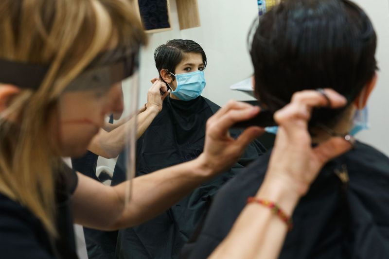 A hair salon reopens in Spain during the coronavirus pandemic