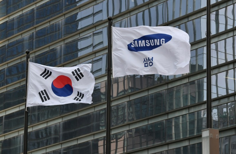 A Samsung flag and a South Korean national flag flutter outside the company's Seocho building in Seoul on May 6.