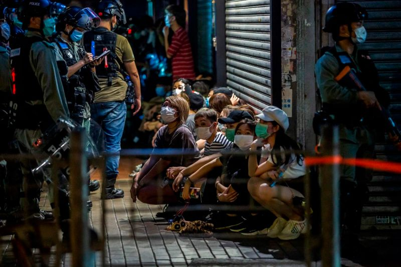 Police detain people during protests in Hong Kong.