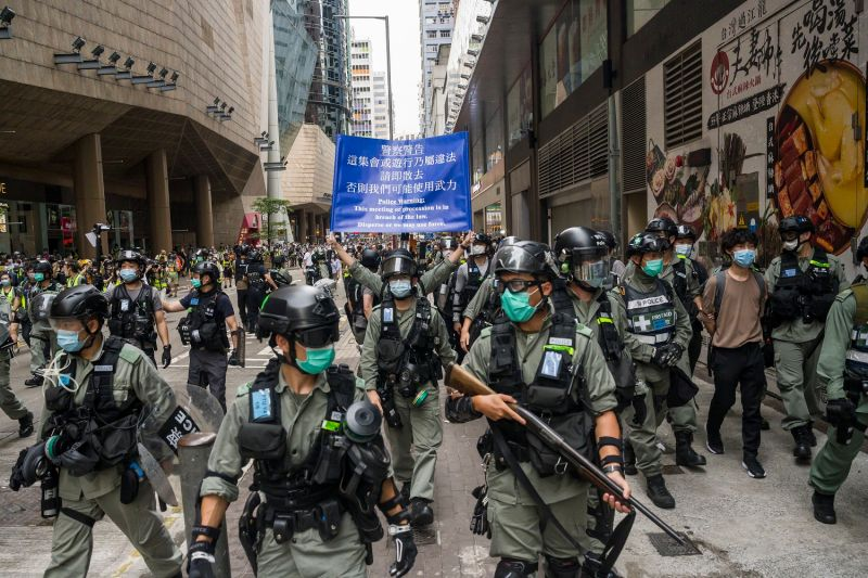 Riot police stand guard during a protest against a planned national security law in the Admiralty district of Hong Kong on May 27.