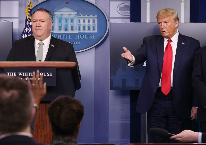 U.S. President Donald Trump (right) and Secretary of State Mike Pompeo participate in the daily coronavirus task force briefing at the White House in Washington on April 8.