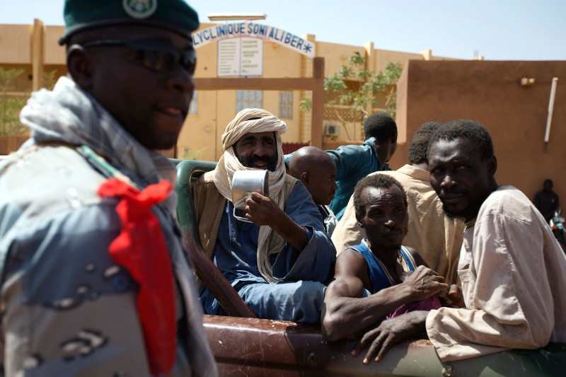 Prisoners charged with belonging to the al Qaeda-affiliated MUJAO armed group are taken out of a jail at the gendarmerie in the northern Malian city of Gao while they wait to be transferred on a military flight to Bamako on Feb. 26, 2013.