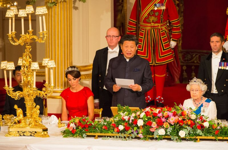 Catherine, Duchess of Cambridge, and Britain's Queen Elizabeth II listen as Chinese President Xi Jinping speaks during a state banquet at Buckingham Palace in London on Oct. 20, 2015.