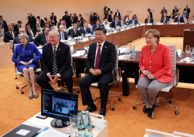 German Chancellor Angela Merkel, U.S. President Donald Trump, and Chinese President  Xi Jinping at the first session of the G-20 summit in Hamburg, Germany, on July 7, 2017.