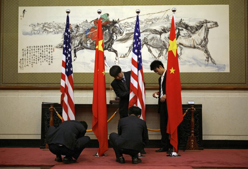 Employees of the state guesthouse set up the flags of China and the United States for the arrival of U.S. Secretary of State Condoleezza Rice ahead of her meeting with Chinese Foreign Minister Yang Jiechi in Beijing on June 29, 2008.