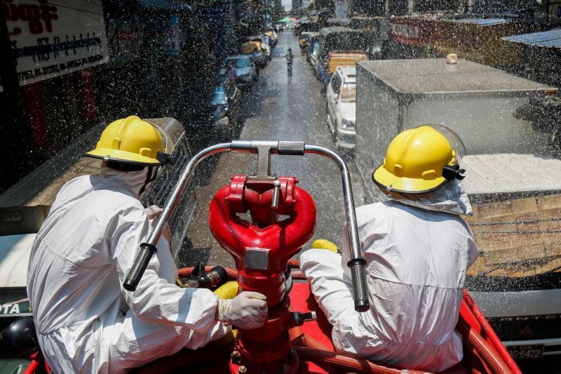 Firefighters spray disinfectant in Yangon, Myanmar.