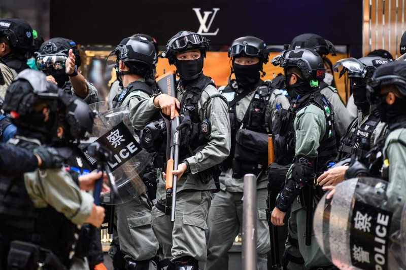 Riot police take part in a crowd dispersal operation in the Central district of Hong Kong on May 27, 2020.