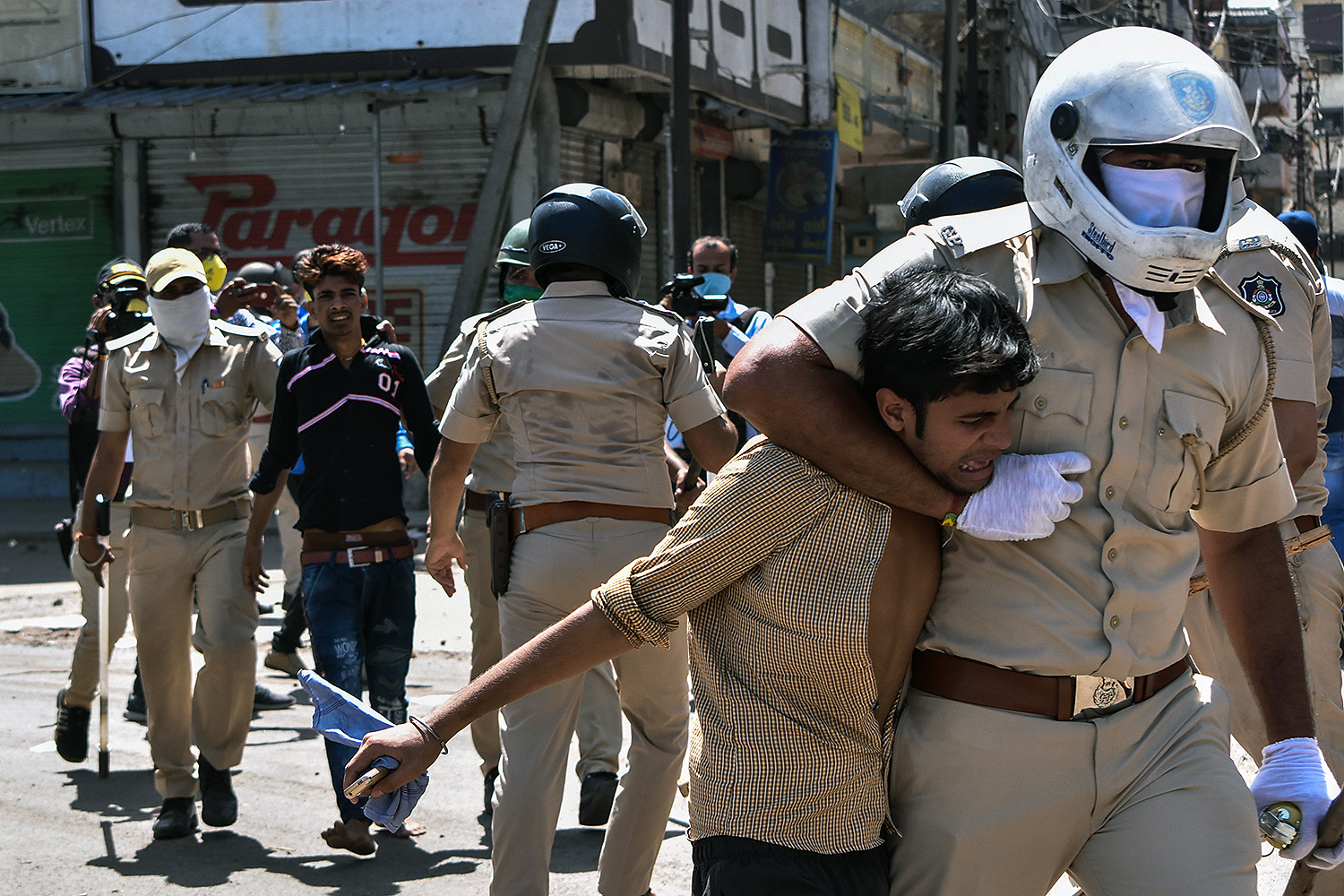 Gujarat police detain stranded migrant workers in the Surat district of India on May 4 during a protest demanding that the government let them return home during the nationwide lockdown. STR/AFP via Getty Images