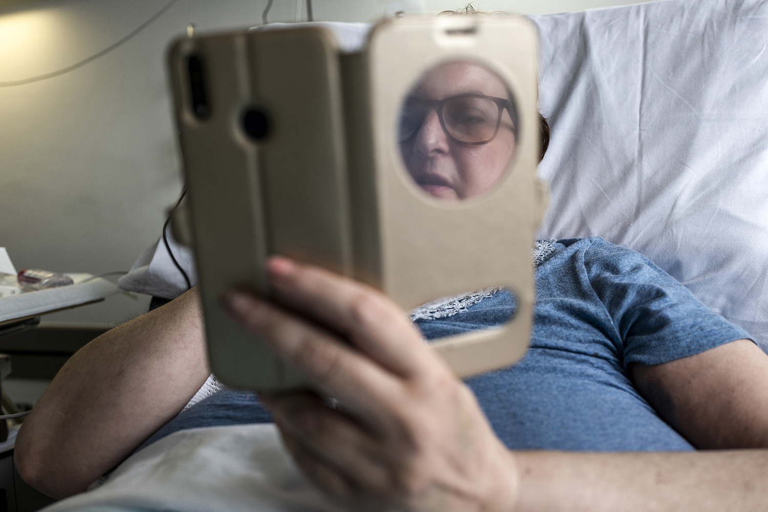 De Nicolo talks by video with her partner, Antonio, as she recovers at the hospital on April 21.