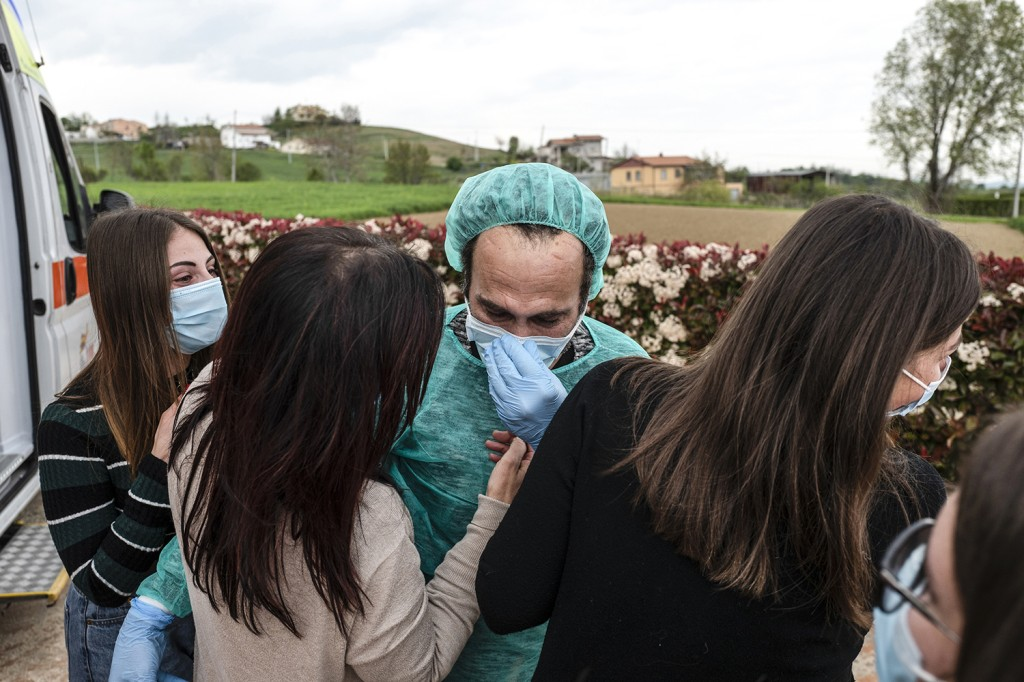 Franco D'Agostino, 54, returns home to his wife, Gabriella, and his three daughters in Penne, Italy, on April 27 after 42 days in the hospital. He spent 19 days in the intensive care unit for respiratory failure due to COVID-19.
