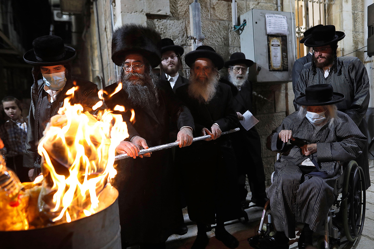 Ultra-Orthodox Jews light a bonfire in Jerusalem's Mea Shearim neighborhood to celebrate the Lag BaOmer holiday May 11 amid the Israeli health ministry's order to maintain social distancing and cancel all celebrations. MENAHEM KAHANA/AFP via Getty Images