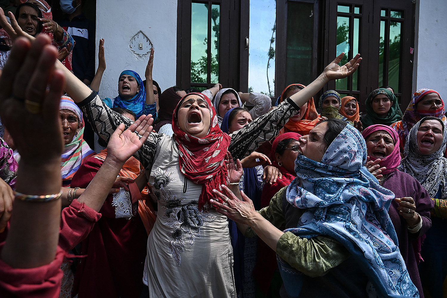 Relatives and neighbors mourn the death of Mehrajudin Shah—who, according to local media reports, was shot by Indian paramilitary troopers after not stopping at a checkpoint—in central Kashmir's Budgam district on May 13. TAUSEEF MUSTAFA/AFP via Getty Images