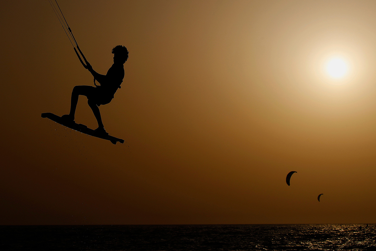 Kite surfers enjoy time on the water at Ramat Poleg beach in the Israeli coastal city of Netanya on May 18, 2020. JACK GUEZ/AFP via Getty Images