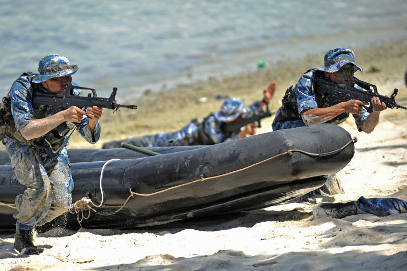 Members of a special squad of the Chinese People's Liberation Army Navy 7th Escort Task Force take part in a joint drill with the Tanzanian marine corps at a Navy base in Dar es Salaam, Tanzania, on March 29, 2011.