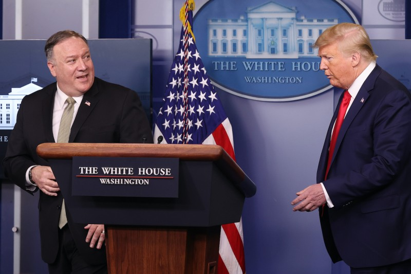 U.S. Secretary of State Mike Pompeo leaves a news conference with President Donald Trump at the White House on April 8.