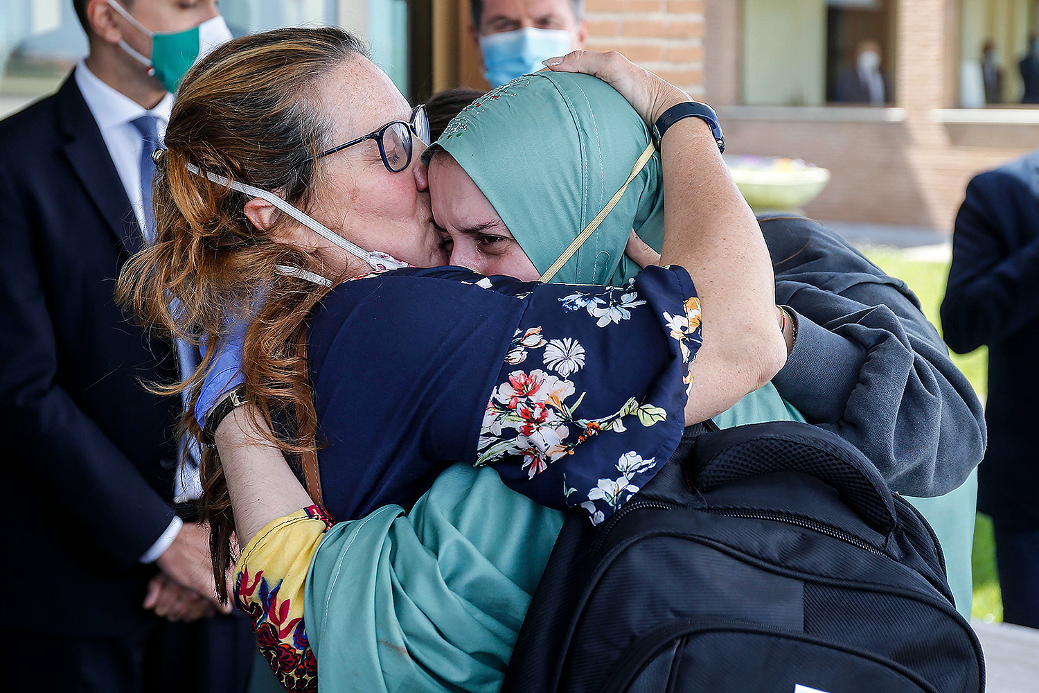 Italian volunteer aid worker Silvia Costanza Romano (right), who was kidnapped in Kenya in late 2018, embraces her mother, Francesca, upon her arrival at Rome's military airport Ciampino on May 11. FABIO FRUSTACI/ANSA/AFP via Getty Images