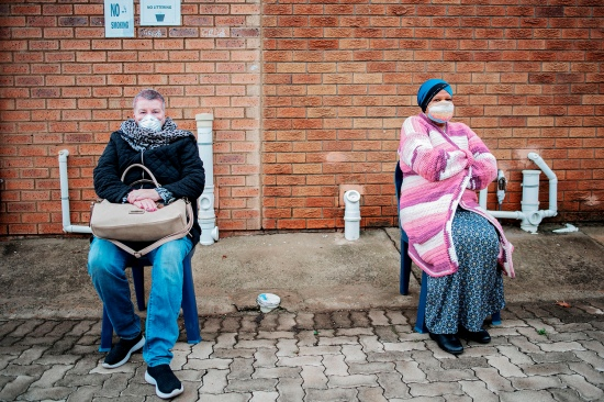 Residents of Johannesburg, South Africa, practice social distancing and mask wearing outside Sophiatown Clinic as they wait to be tested for COVID-19 on April 28.