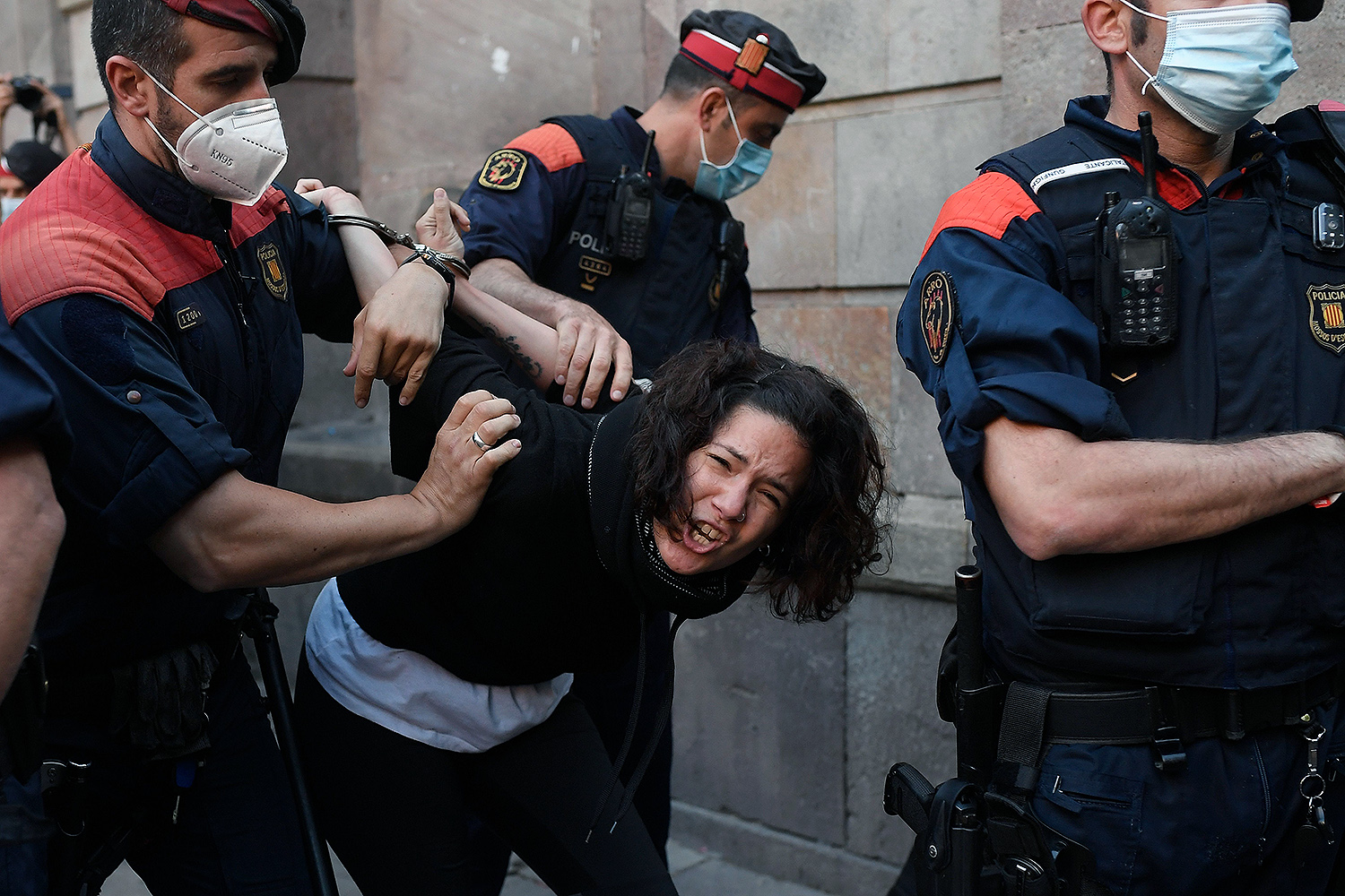 Members of the Catalan regional police grab a protester during a demonstration by the Catalan pro-independence group in Barcelona, Spain, on May 19. JOSEP LAGO/AFP via Getty Images
