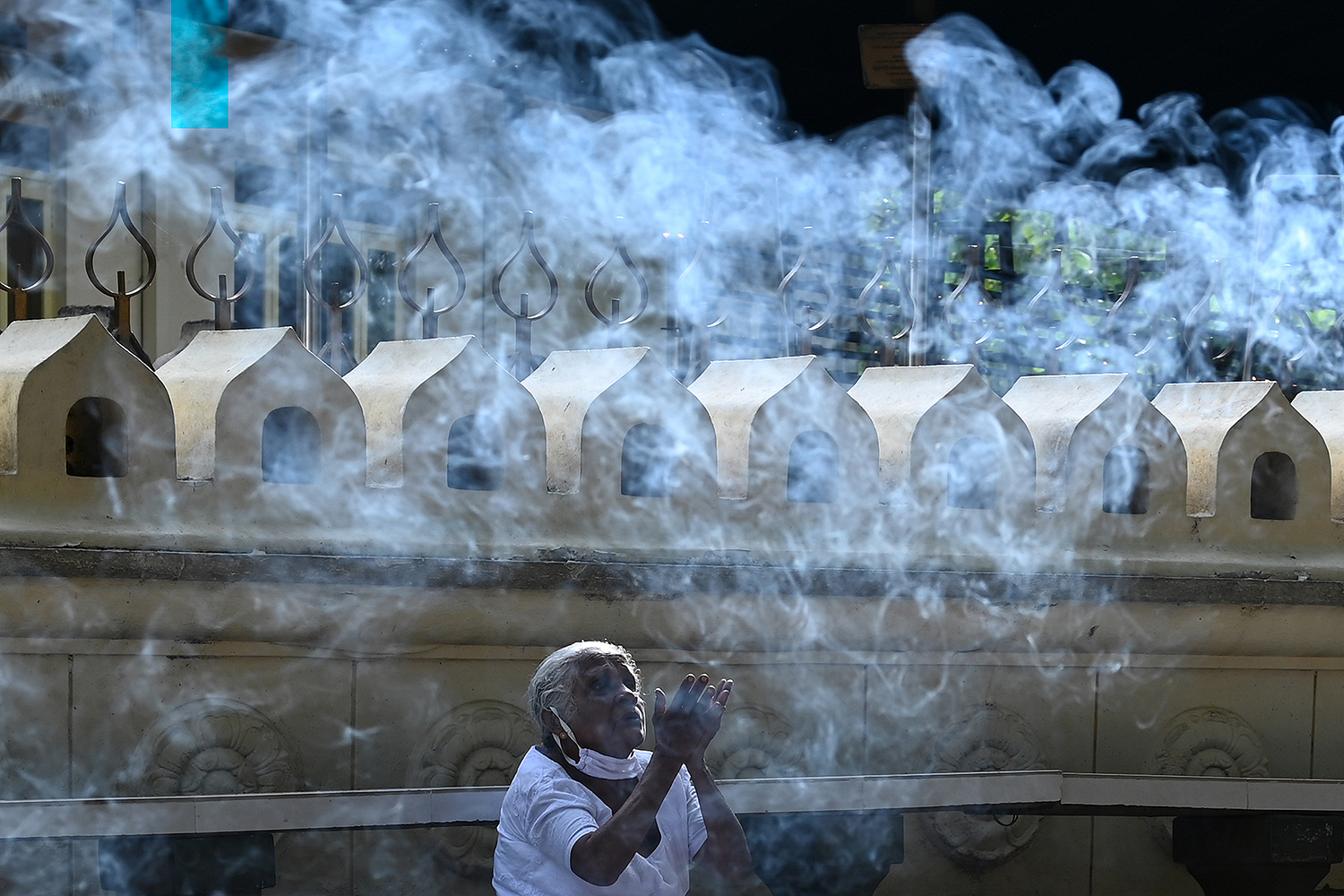 A Buddhist devotee prays during Vesak, the most sacred day for Buddhists, at the Bellanwila Temple in Colombo, Sri Lanka, on May 7. LAKRUWAN WANNIARACHCHI/AFP via Getty Images