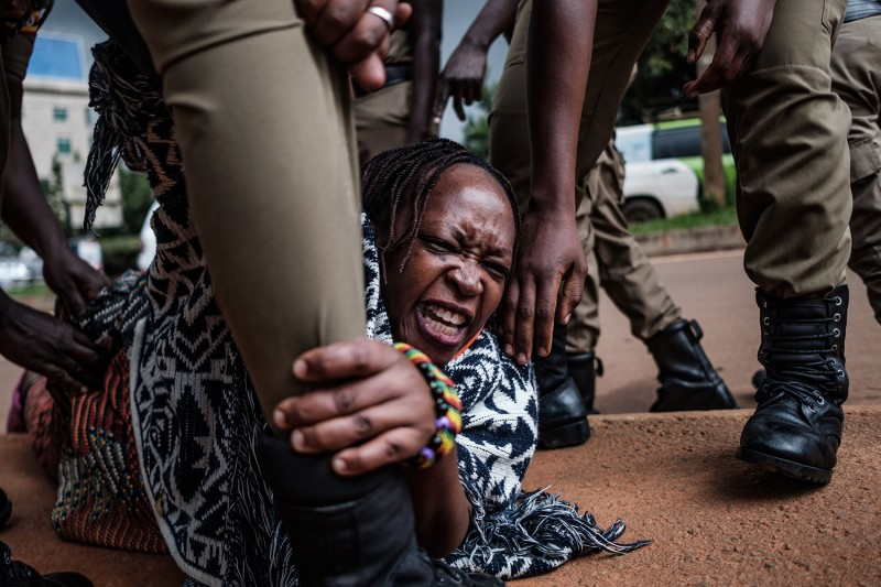 Stella Nyanzi, a prominent Ugandan activist and government critic, is arrested by police officers in Kampala on May 18 during a protest she organized calling for more food distributions by the government to people who have been financially struggling by the nationwide lockdown. SUMY SADURNI/AFP via Getty Images