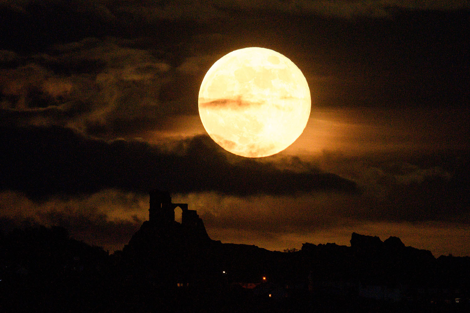 A supermoon rises over Mow Cop Castle near Stoke-on-Trent in central England on May 7. OLI SCARFF/AFP via Getty Images