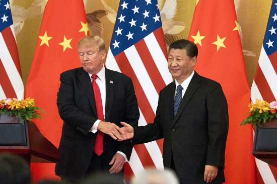 U.S. President Donald Trump and Chinese President Xi Jinping end their handshake at a press conference at the Great Hall of the People in Beijing on Nov. 9, 2017. Since taking office, the Trump administration has sought to decouple economically from China.