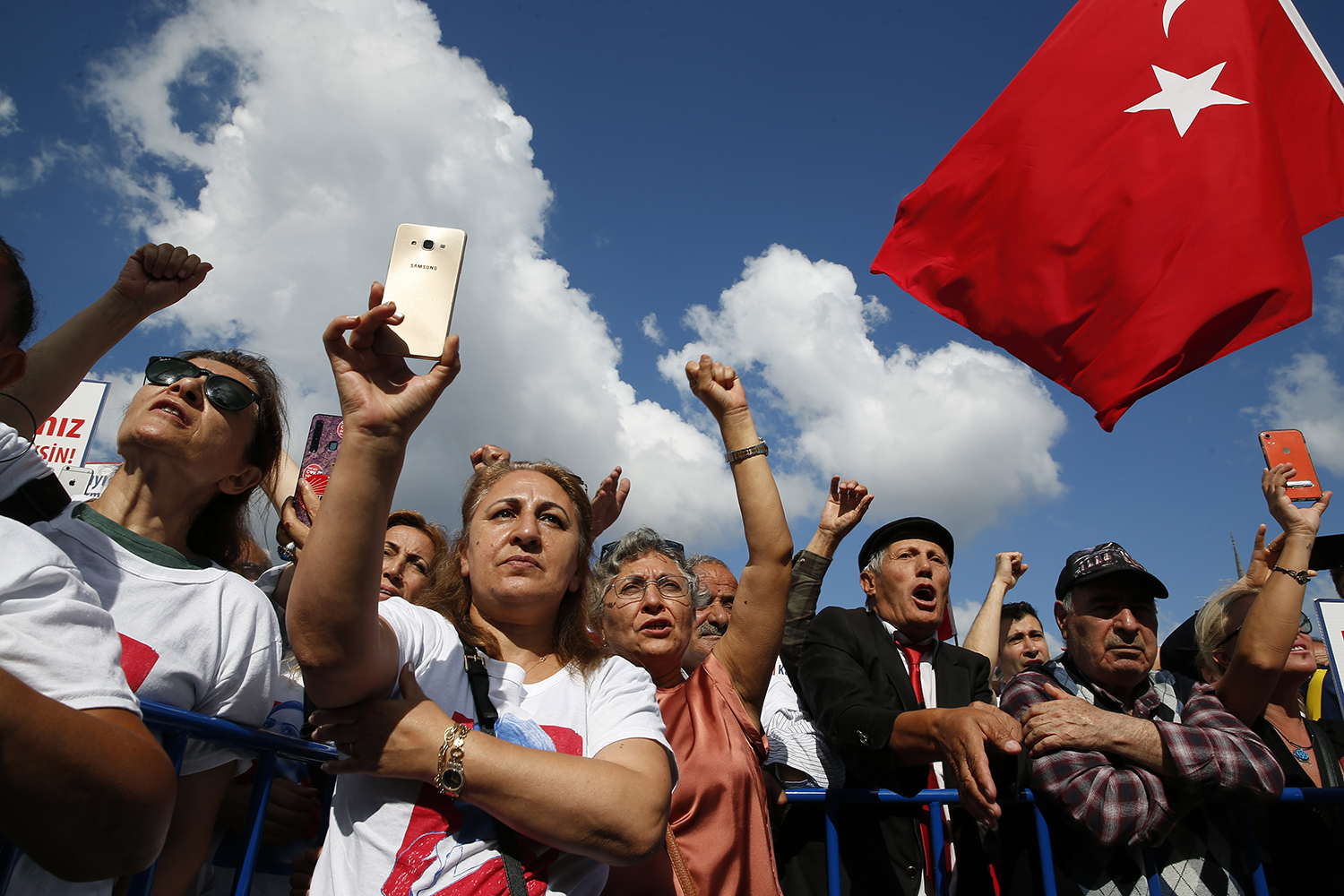 Supporters of Kaftancioglu chant slogans during a rally outside a court in Istanbul where she was standing trial on July 18, 2019.