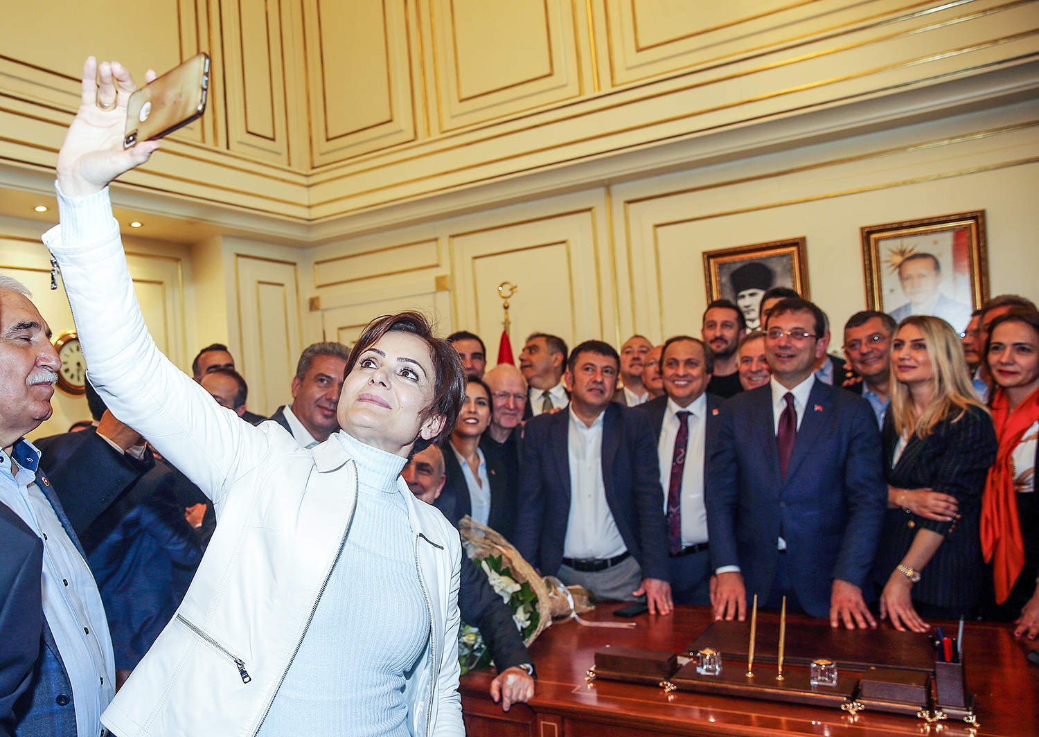 Kaftancioglu takes a selfie as Istanbul mayor-elect Ekrem Imamoglu poses after taking his post from the former Istanbul mayor during the handover ceremony at Istanbul Metropolitan Municipality building on April 17, 2019.