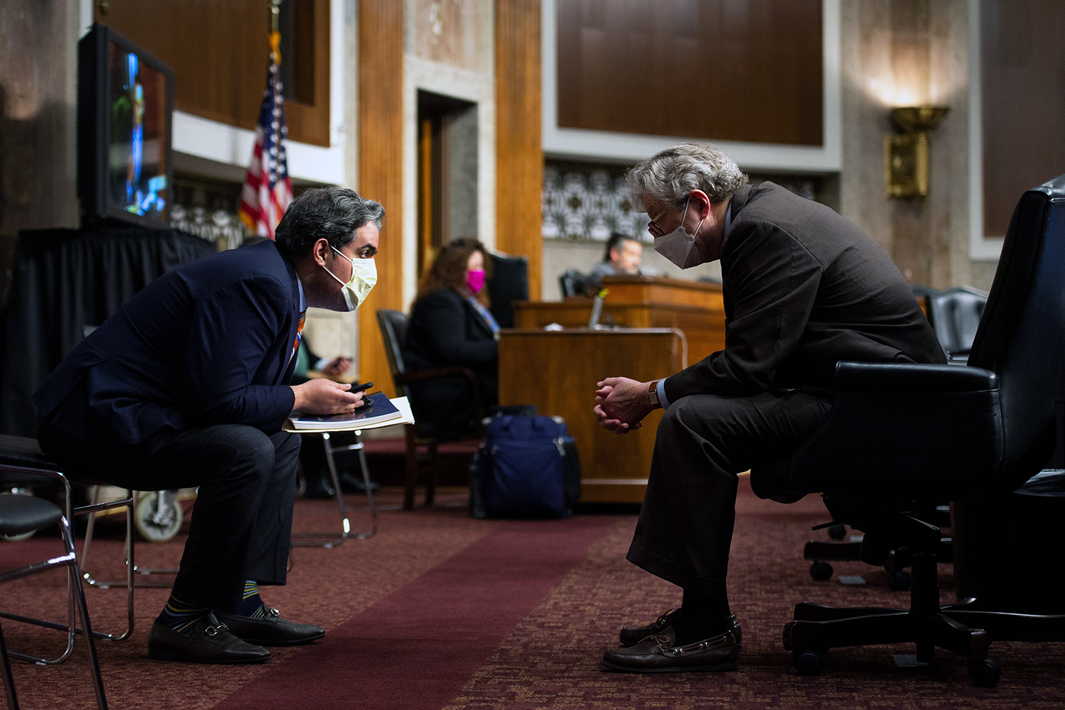 U.S. Sen. John Kennedy (right) speaks with a staff member during a Senate Judiciary Committee nomination hearing on Capitol Hill in Washington, D.C., on May 6. CAROLINE BREHMAN/POOL/AFP via Getty Images
