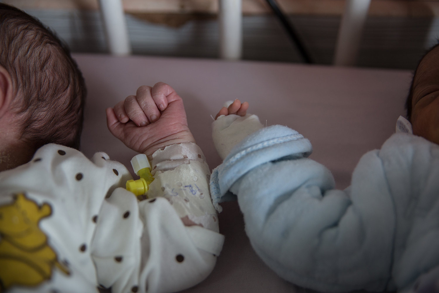 Newborn babies—whose mothers have not been found yet—lie at Ataturk Hospital in Kabul on May 13 after the maternity ward attack.