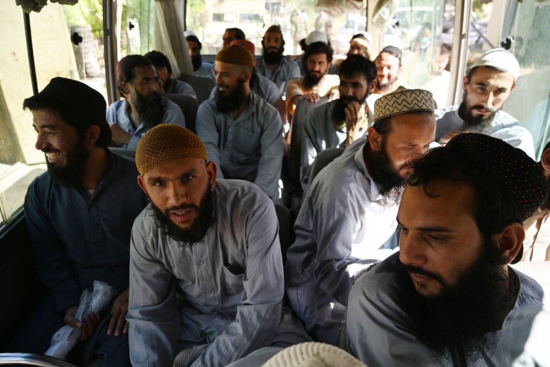 Taliban prisoners sit inside a vehicle during their release from Bagram prison 50km north of Kabul.