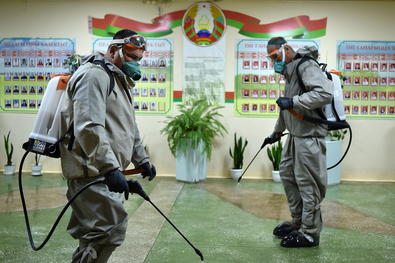 Belarus servicemen wearing protective gear disinfect a school in the village of Mikhanavichy outside Minsk on May 3.