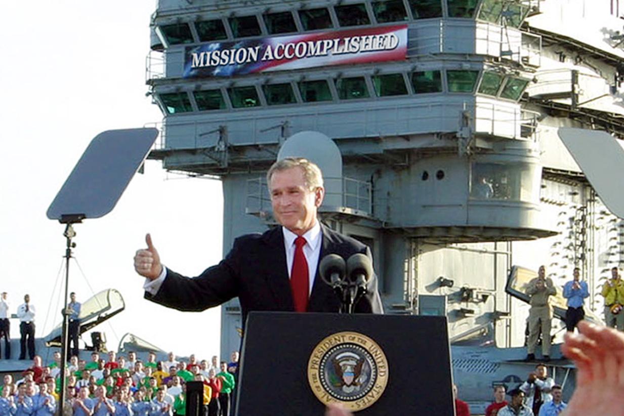 bush-mission-accomplished-2003-iraq-trump-coronavirus-AP_03050109208-crop.jpg