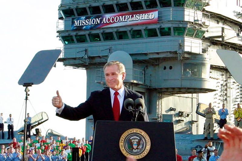 "President George W. Bush declares the end of major combat in Iraq under a ""Mission Accomplished"" banner aboard the aircraft carrier Abraham Lincoln off the California coast on May 1, 2003."