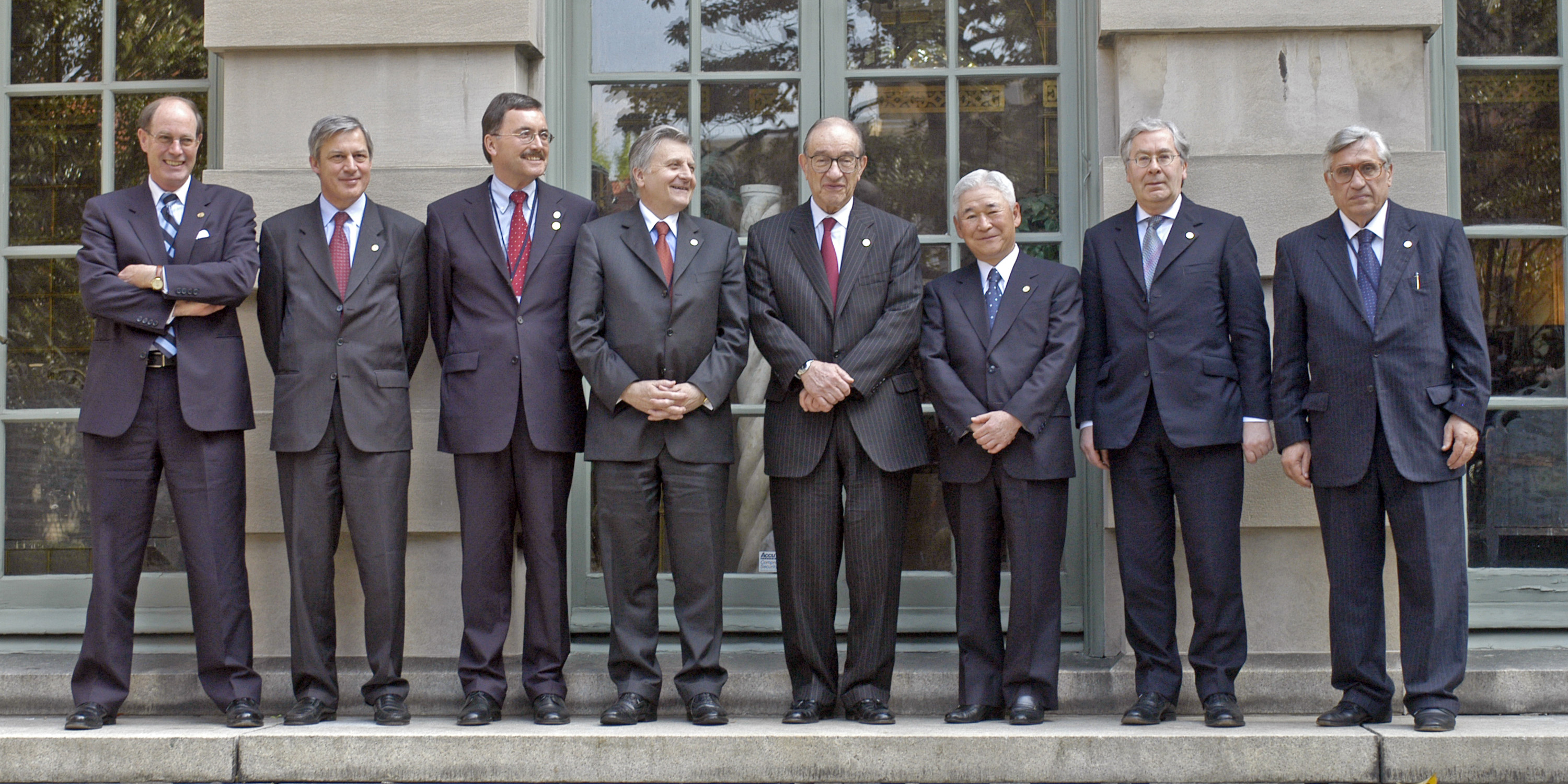 Central Bank members gather for a G-7 meeting in Washington in April 2004, including David Dodge of Canada, Christian Noyer of France, Bundesbank vice-president Juergen Stark of Germany, Jean Claude Trichet President of the European Central Bank, Chairman of the Federal Reserve Alan Greenspan, Bank of Japan Governor Toshihiko Fukui, Mervin King of the United Kingdom, and Antonio Fazio of Italy.